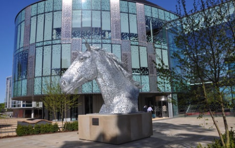 photo of the exterior of Roslin Innovation Centre, Easter Bush Campus with Canter horse statue in foreground - credit Roslin Innovation Centre