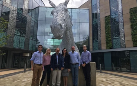 AskBio team outside Roslin Innovation Centre by Canter sculpture